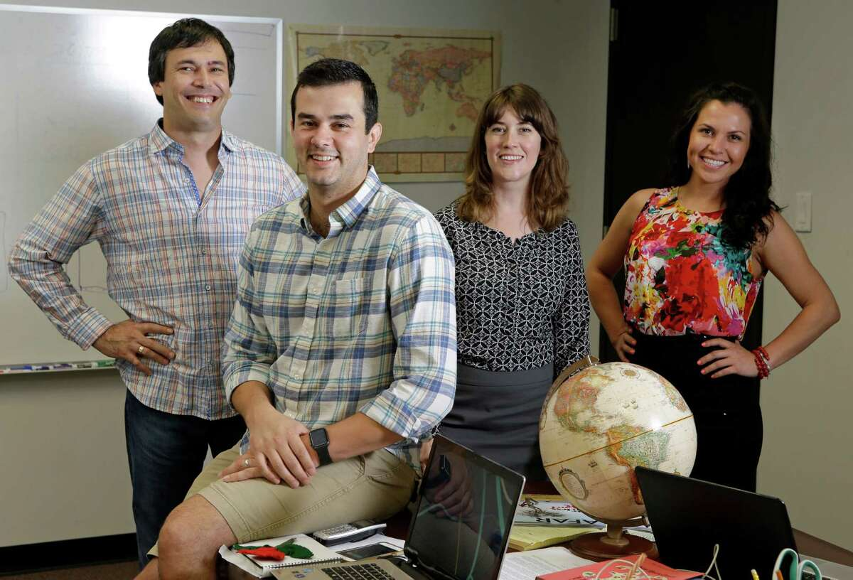 Lawrence Kalinov, left, Bobby Mansour, Meredith Kalinov, and Stela Tomova, right, pose at their office Thursday, July 28, 2016, in Houston. They are the founders of Pangea196, arranges for mobile professionals to spend a year working from 12 different locations around the world.