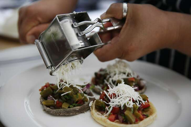 13. Queso frisco from Sonoma is added to the final nopales product in Lugo's kitchen June 14, 2016 in Berkeley, Calif.