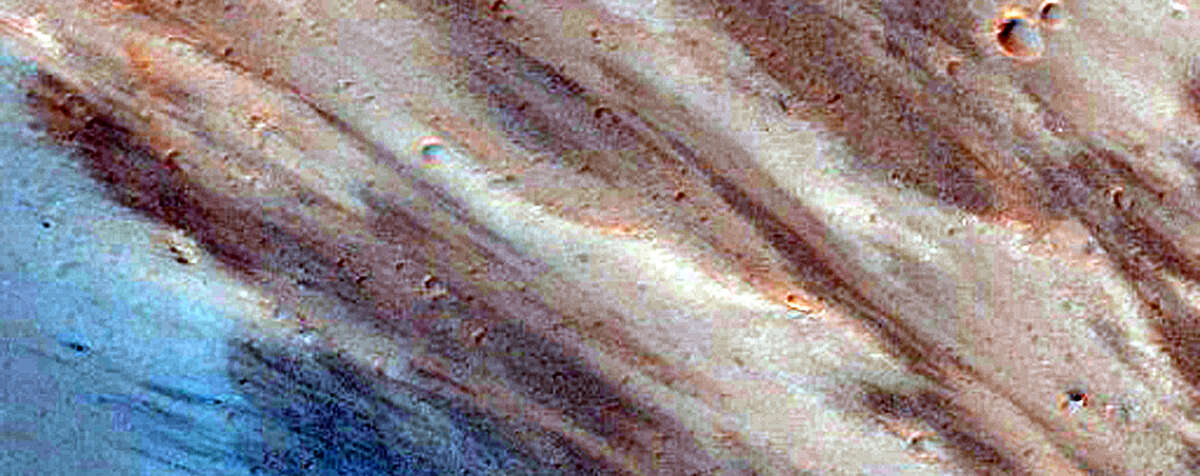 NASA released more than 1,000 new images captured by the Mars Reconnaissance Orbiter.