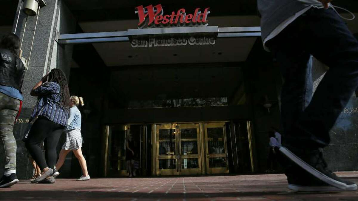 Pedestrians on Market Street walk past an entrance to Westfield San Francisco Centre on Friday, September 25, 2015 in San Francisco, Calif. On Wednesday morning, 28-year-old Frank Galicia was found dead at the shopping center and authorities have ruled the death a homicide.