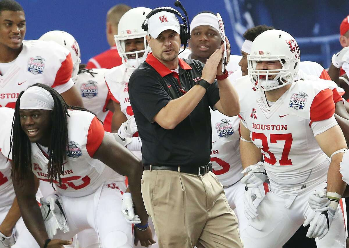 FILE - In this Dec. 31, 2015, file photo, Houston head coach Tom Herman watches play against Florida State during the first half of the Peach Bowl NCAA college football game in Atlanta. The AAC notched 10 wins in 2015 against Power Five conference teams, including Mississippi, Miami, Penn State and Louisville. The Cougars' 38-24 victory against Florida State was the highlight, a final statement that helped the American recover from what was otherwise a blah bowl season. (AP Photo/John Bazemore, File)