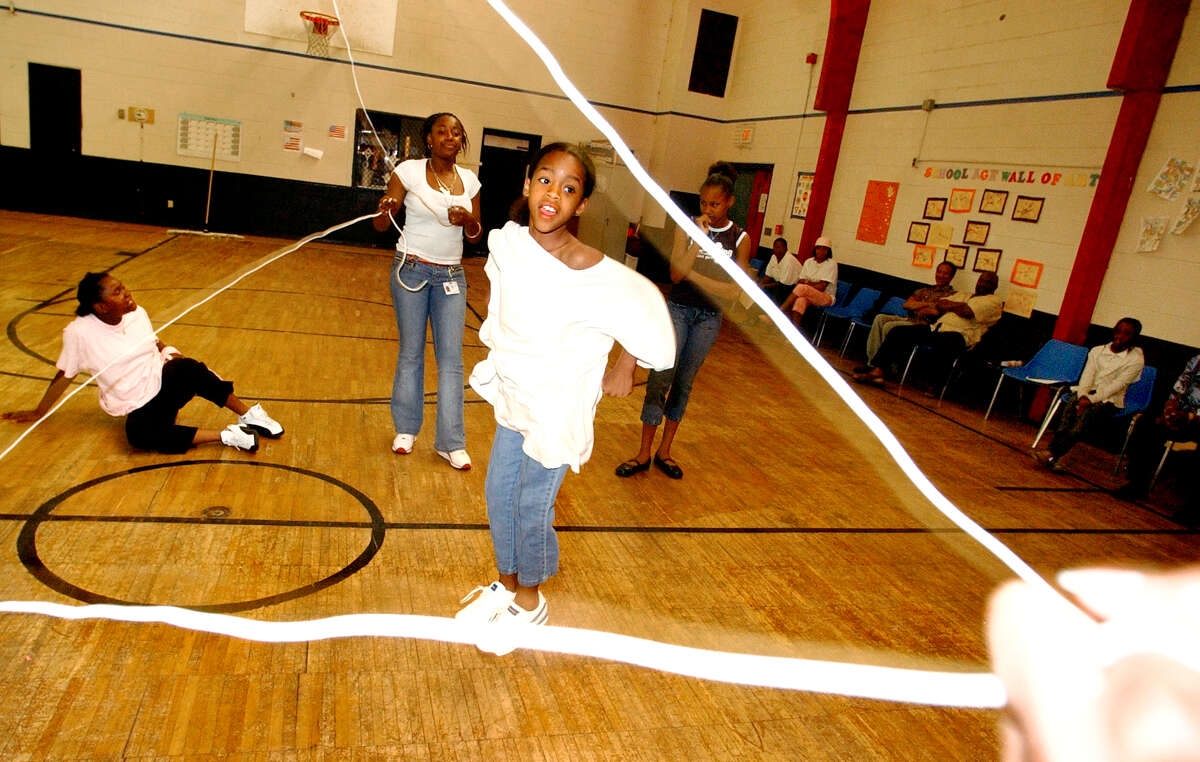 Times Union staff photo by Cindy Schultz Helena Anderson, 10, center, jumps Double Dutch on Thursday, July 15, 2004, at the Carver Community Center in Schenectady, N.Y.