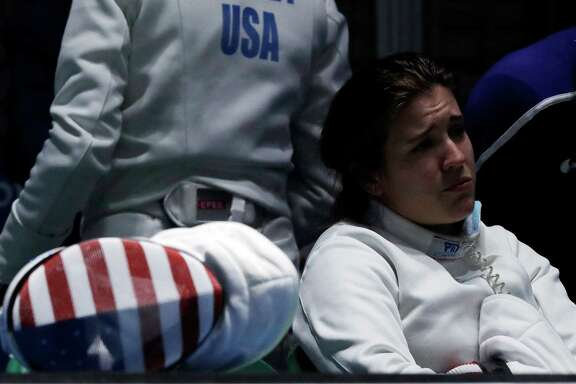 Courtney Hurley of the United States watches her teammates compete in a women's team fencing quarterfinal at the 2016 Summer Olympics in Rio de Janeiro, Brazil, Thursday, Aug. 11, 2016. (AP Photo/Andrew Medichini)