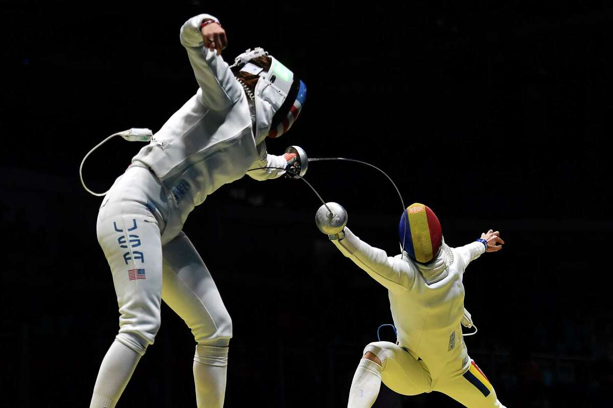 US Kelley Hurley (L) competes against Romania's Simona Gherman during the womens team epee quarter-final bout between US and Romania as part of the fencing event of the Rio 2016 Olympic Games, on August 11, 2016, at the Carioca Arena 3, in Rio de Janeiro. / AFP PHOTO / Fabrice COFFRINIFABRICE COFFRINI/AFP/Getty Images