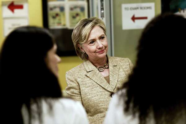 Hillary Clinton, the Democratic presidential nominee, greets members of the staff as she tours the Borinquen Health Care Center in Miami on Tuesday. A new batch of State Department emails released Tuesday showed the close and sometimes overlapping interests between the Clinton Foundation and the State Department when Clinton served as secretary of state.