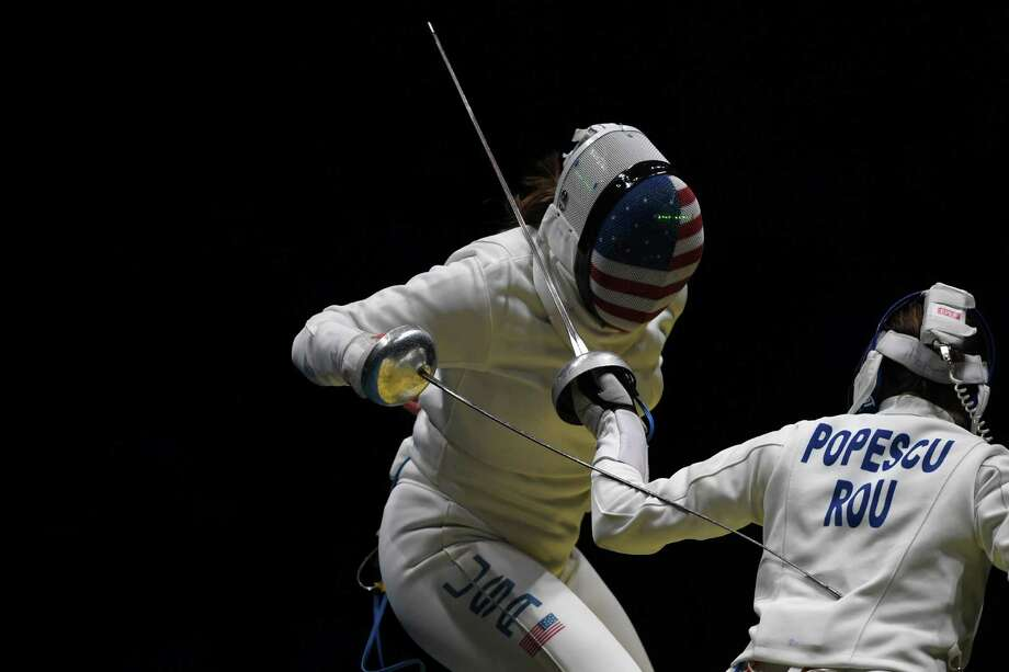 USA's Courtney Hurley (left) competes against Romania's Ana Maria Popescu during the women's team epee quarterfinal bout as part of the fencing event of the Rio 2016 Olympic Games, on Aug. 11, 2016, at the Carioca Arena 3, in Rio de Janeiro. Photo: Kirill Kudryavtsev /Getty Images / AFP or licensors