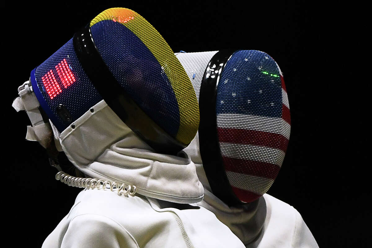 Romania's Ana Maria Popescu (left) and USA's Courtney Hurley react during the women's team epee quarterfinal bout as part of the fencing event of the Rio 2016 Olympic Games, on Aug. 11, 2016, at the Carioca Arena 3, in Rio de Janeiro.