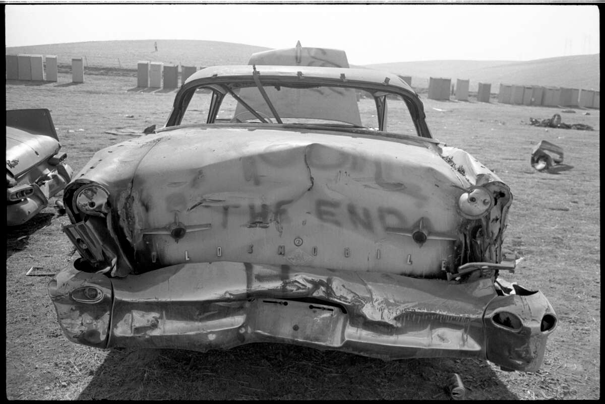 Damaged cars on the day after the Altamont concert.