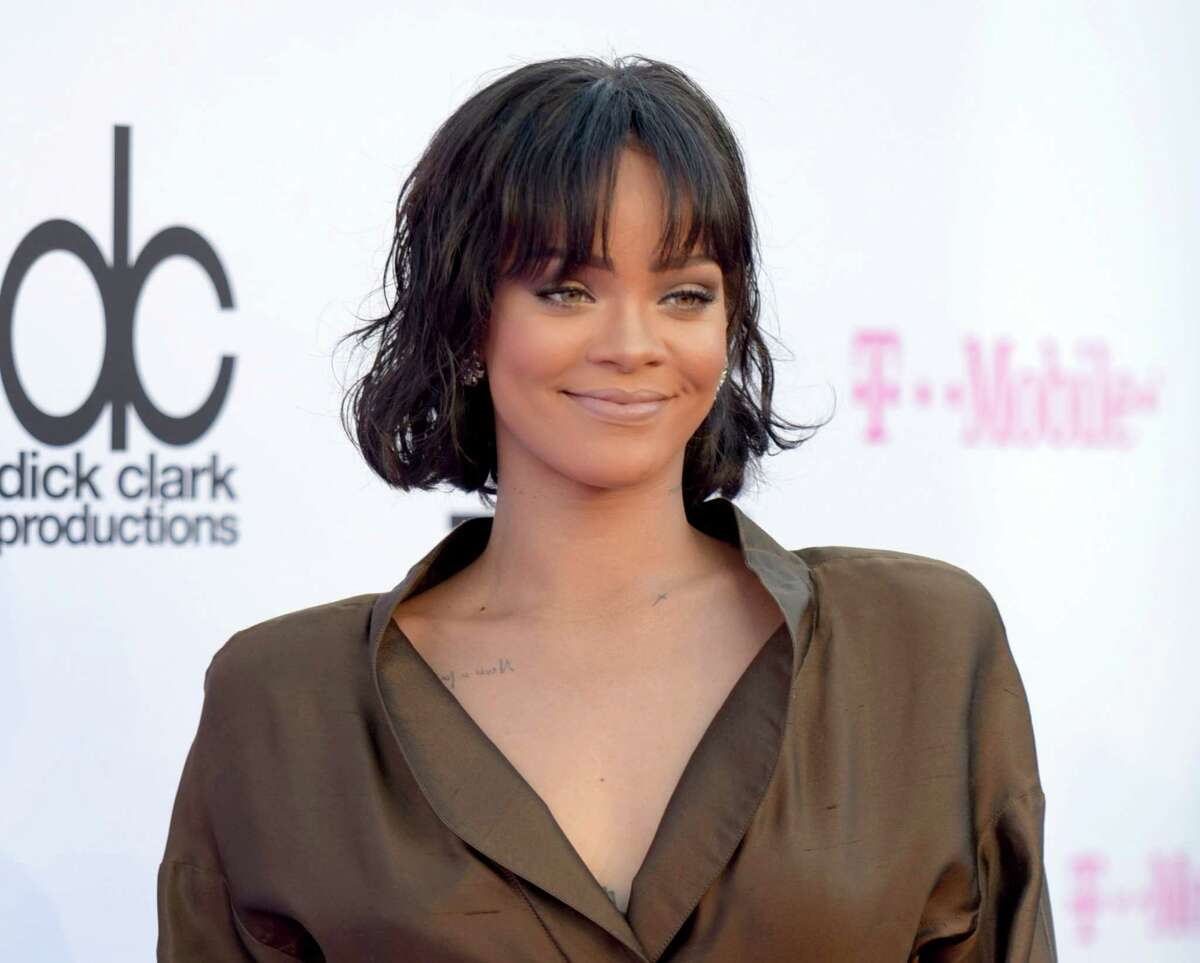FILE - In this May 22, 2016 file photo, Rihanna arrives at the Billboard Music Awards in Las Vegas. MTV announced Thursday, Aug. 11, 2016, that Rihanna, who released her first album in 2005, will earn the Michael Jackson video vanguard award at the Aug. 28 show in New York. (Photo by Richard Shotwell/Invision/AP, File) ORG XMIT: NYET403
