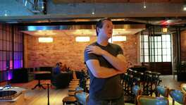 """Jazz, Tx, venue owner and musician Brent """"Doc"""" Watkins talks about the new jazz club/restaurant at the Pearl Brewery, Wednesday, August 10, 2016. The club was designed by architect Jonathan Card, of Clayton and Little and will open in the near future. It is located in the basement of the new Bottling Department at the Pearl. The building is a replica of the original building that was at a different location at the Pearl. The stage features a photograph of the Texas Hill Country near Leakey, Texas."""