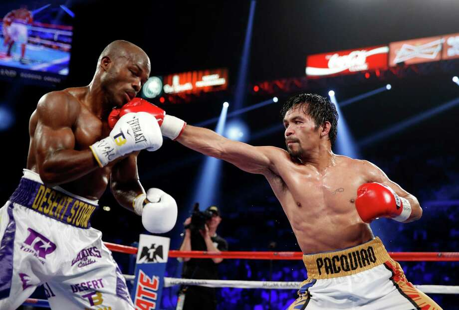 Manny Pacquiao fights Timothy Bradley during a welterweight title boxing match on April 9, 2016, in Las Vegas. Photo: Isaac Brekken /Associated Press / FR159466 AP