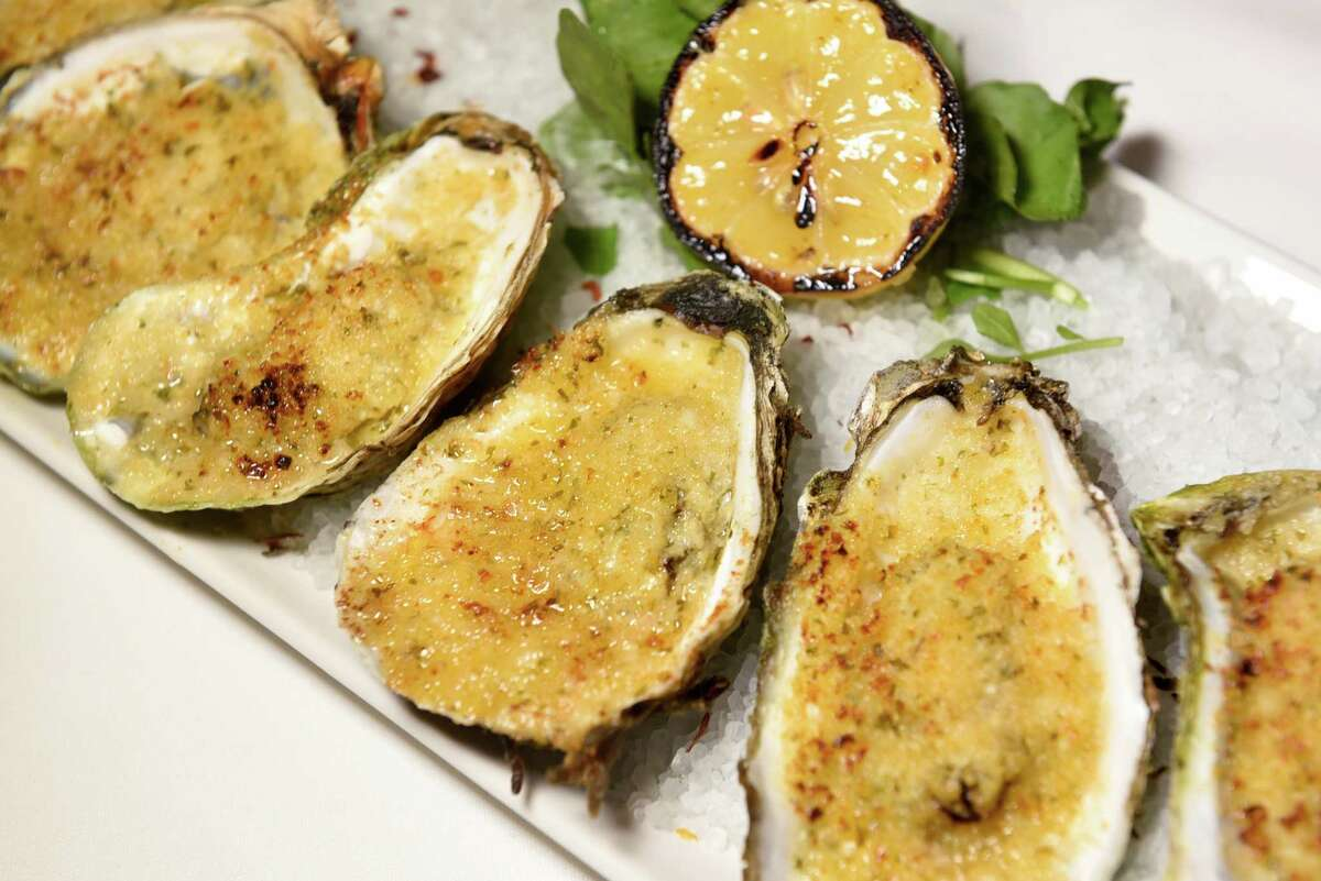 Grilled Oysters feature blue point oysters with garlic herb butter and panko on Thursday, Aug. 4, 2016, Morton's The Steakhouse in Saratoga Springs, N.Y. (Cindy Schultz / Times Union)