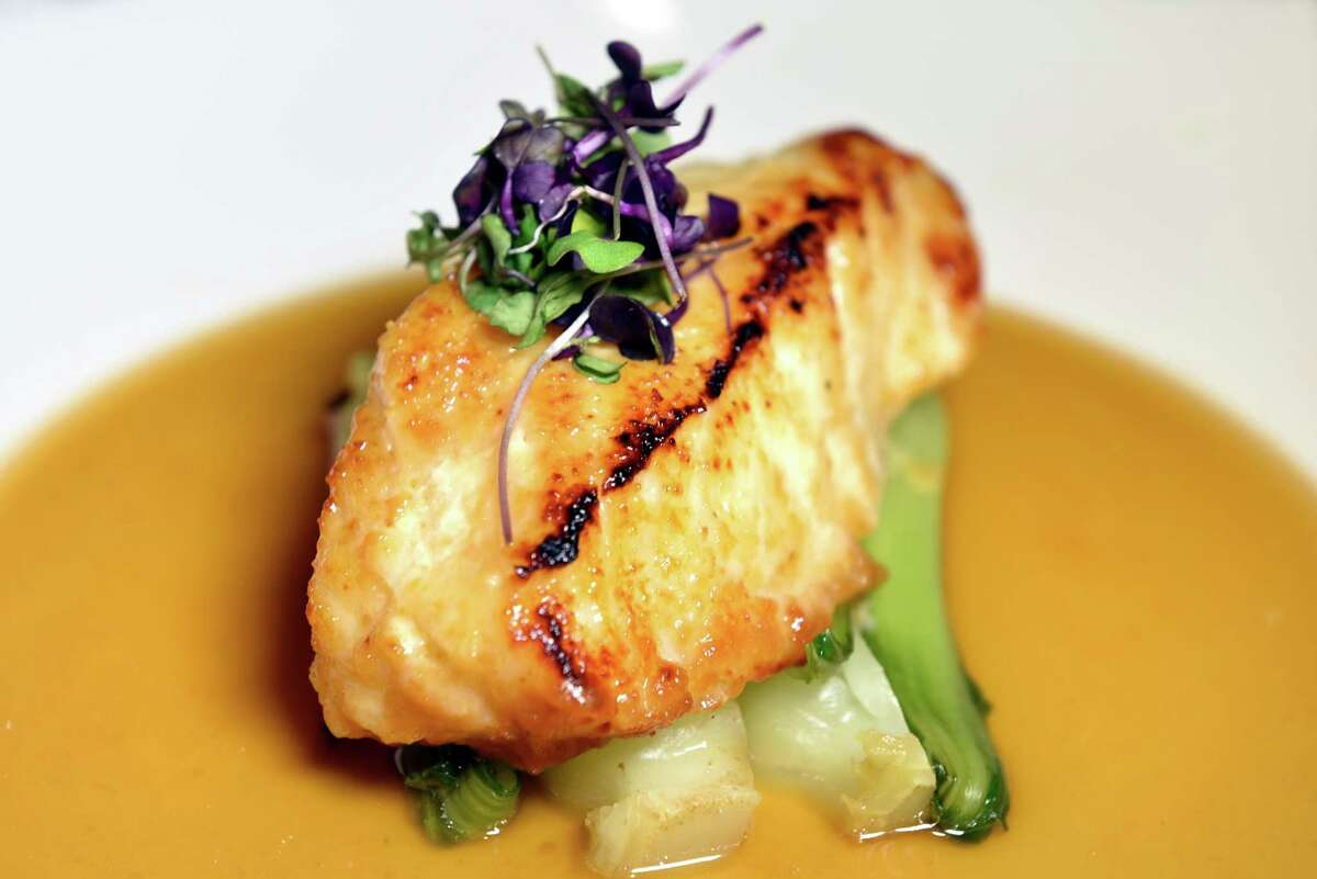 Miso Marinated Sea Bass with dashi broth and steamed bok choy on Thursday, Aug. 4, 2016, Morton's The Steakhouse in Saratoga Springs, N.Y. (Cindy Schultz / Times Union)
