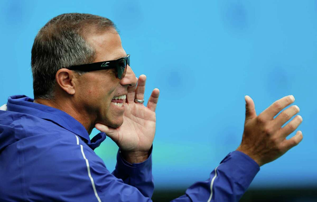 United States' coach Adam Krikorian watches his team play against China during their women's water polo preliminary round match at the 2016 Summer Olympics in Rio de Janeiro, Brazil, Thursday, Aug. 11, 2016. (AP Photo/Sergei Grits)