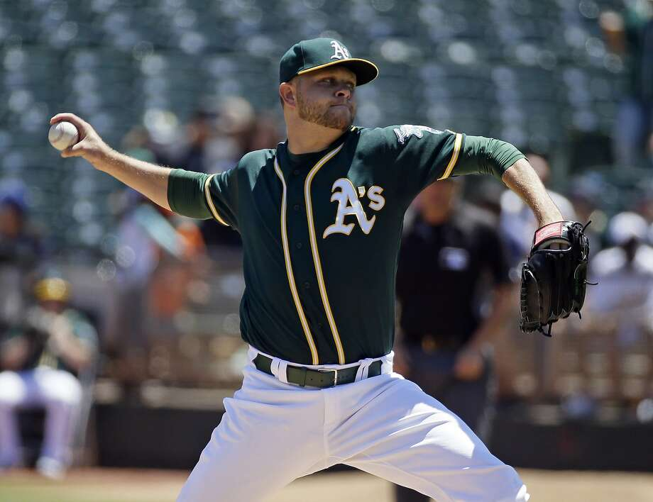 Oakland Athletics starting pitcher Jesse Hahn throws against the Tampa Bay Rays in the first inning of a baseball game Sunday, July 24, 2016, in Oakland, Calif. (AP Photo/Eric Risberg) Photo: Eric Risberg, Associated Press