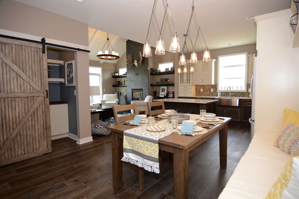 Living space inside the Aston model townhouse at Malta Springs, a Barbera Homes development.