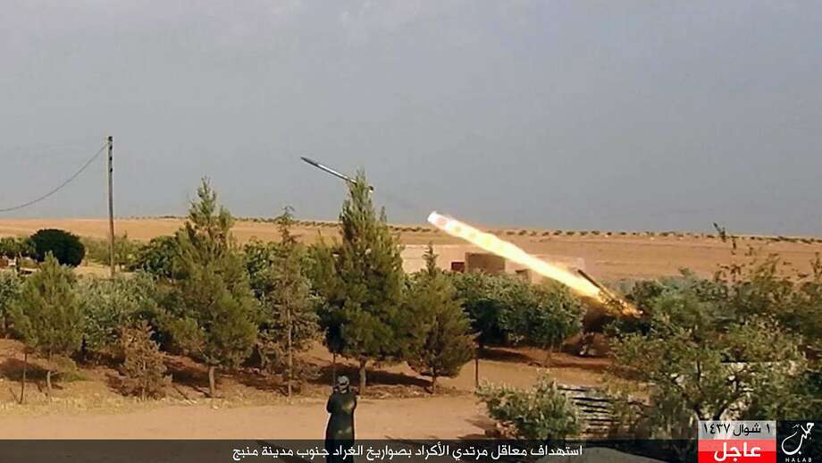 Islamic State forces fire a rocket in Aleppo, Syria, in July. The militants' key city, Raqaa, is under attack. Photo: Uncredited, Associated Press