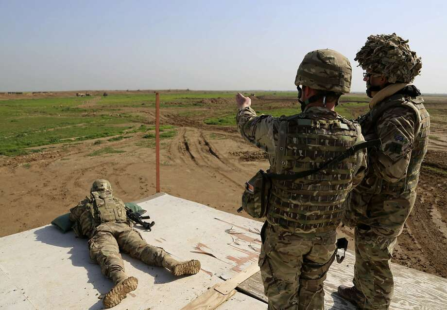 U.S. and Spanish troops conduct training exercises at Basmaya base near Baghdad in January. A House task force says intelligence assessments exaggerated progress against Islamic State. Photo: Karim Kadim, Associated Press