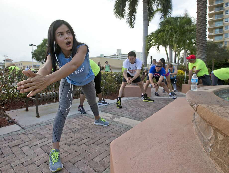 Runners stretch out near the Running Wild store before heading out to the Westin Fort Lauderdale Beach Resort during their weekly run in the Florida city. Photo: Wilfredo Lee, Associated Press
