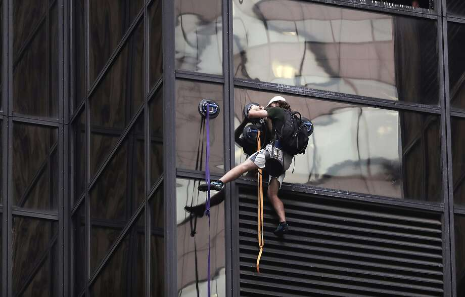 Stephen Rogata scales the glass facade of Trump Tower in New York before his arrest Wednesday. Photo: Julie Jacobson, Associated Press