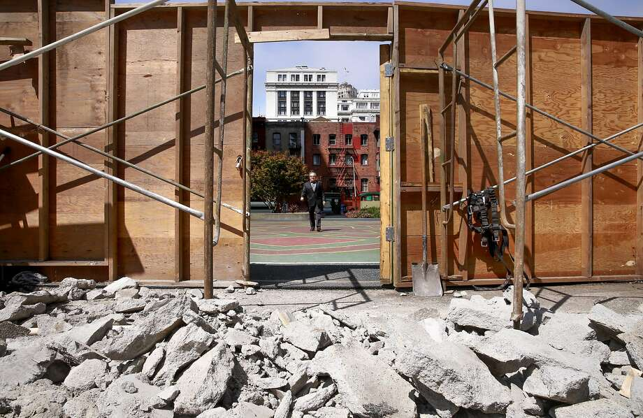 Architect Jeffrey Heller walks across St. Mary's Square which will join the rooftop terrace when completed of 500 Pine St. on the corner of Kearny and Pine streets in downtown San Francisco, California, as seen on Thurs. Aug. 10, 2016. Photo: Michael Macor, The Chronicle
