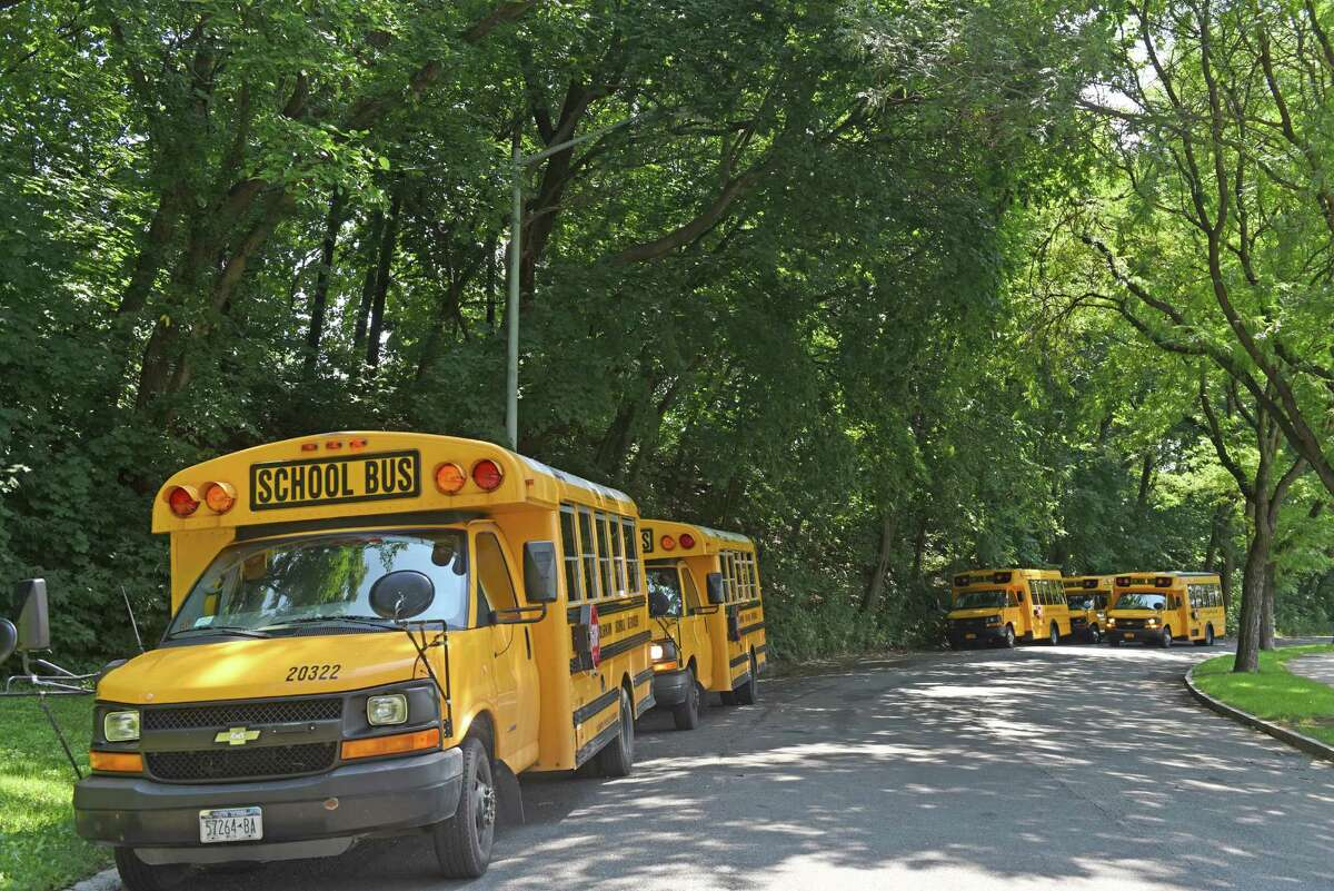 A lineup of school buses at the ready to transport those wanting to swim from the closed Lincoln Park pool on Thursday Aug. 11, 2016 in Albany, N.Y. Eleven spray pads around Albany will be open from 10 a.m. to 6 p.m. The Myers Middle School pool will be open from noon until 7 p.m., and the Mater Christi pool will be open from 11 a.m. to 7 p.m. (Michael P. Farrell/Times Union)