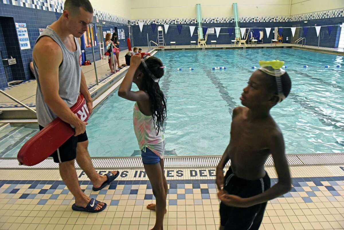Life guard supervisor Conor Driscoll talks with young swimmers at the Myers Middle School pool on Thursday Aug. 11, 2016 in Albany, N.Y. (Michael P. Farrell/Times Union)