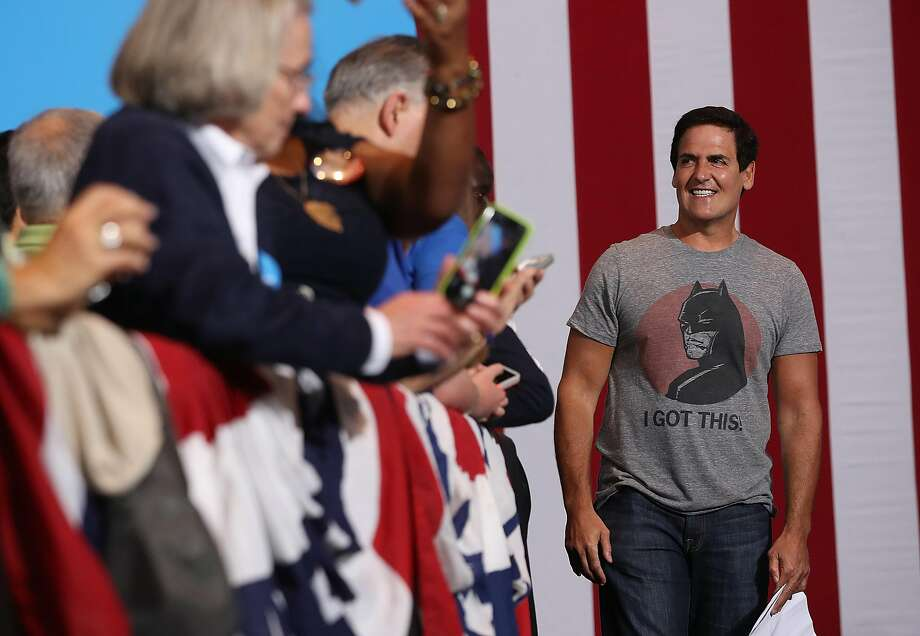 Tech entrepreneur Mark Cuban greets the crowd before introducing Demo