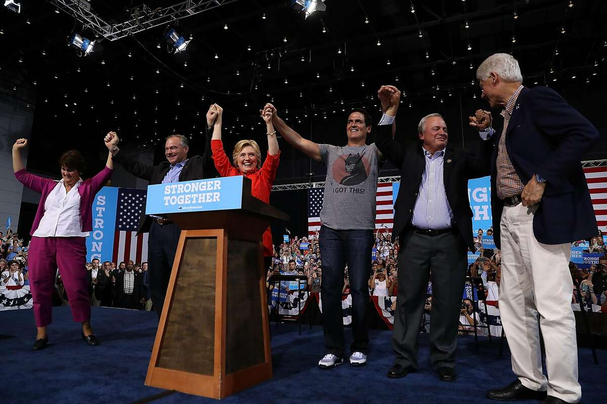 PITTSBURGH, PA - JULY 30: (L-R) Anne Holton, democratic vice presidential nominee U.S. Sen Tim Kaine (D-VA), democratic presidential nominee former Secretary of State Hillary Clinton, Mark Cuban, U.S. Rep. Mike Doyle (D-PA) and former U.S. president Bill Clinton raise arms during a campaign rally with at the David L. Lawrence Convention Center on July 30, 2016 in Pittsburgh, Pennsylvania. Hillary Clinton and Tim Kaine are continuing their three-day bus tour through Pennsylvania and Ohio. (Photo by Justin Sullivan/Getty Images)