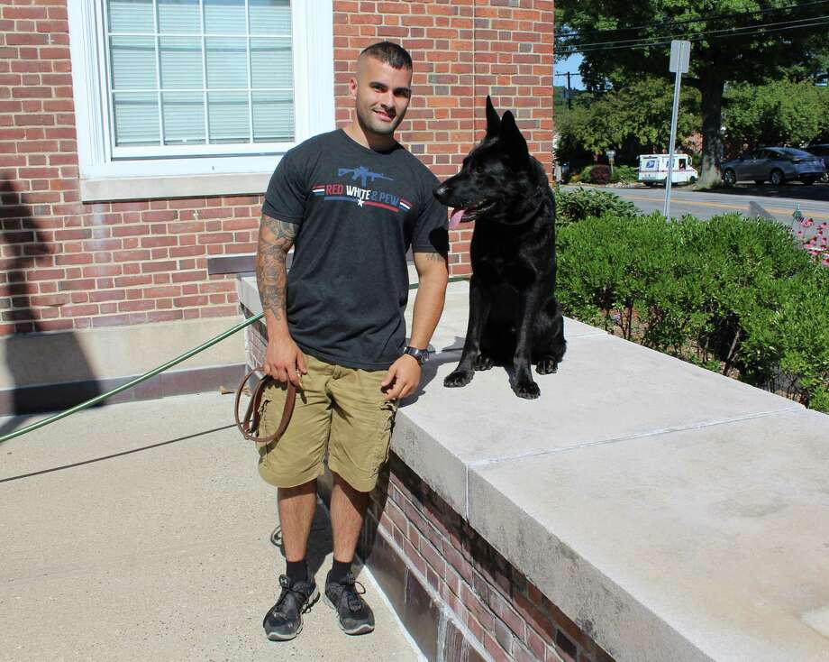 Officer David Scinto, who has been with Westport Police for three and a half years, is joining the department's K9 unit with new police dog Atlas. Scinto bought Atlas as his personal dog, but the 19-month-old German Shepherd will now join the force with his owner. Scinto and Atlas were photographed Aug. 4, 2016 at the police department in Westport, Conn. Photo: Laura Weiss / Hearst Connecticut Media / Westport News