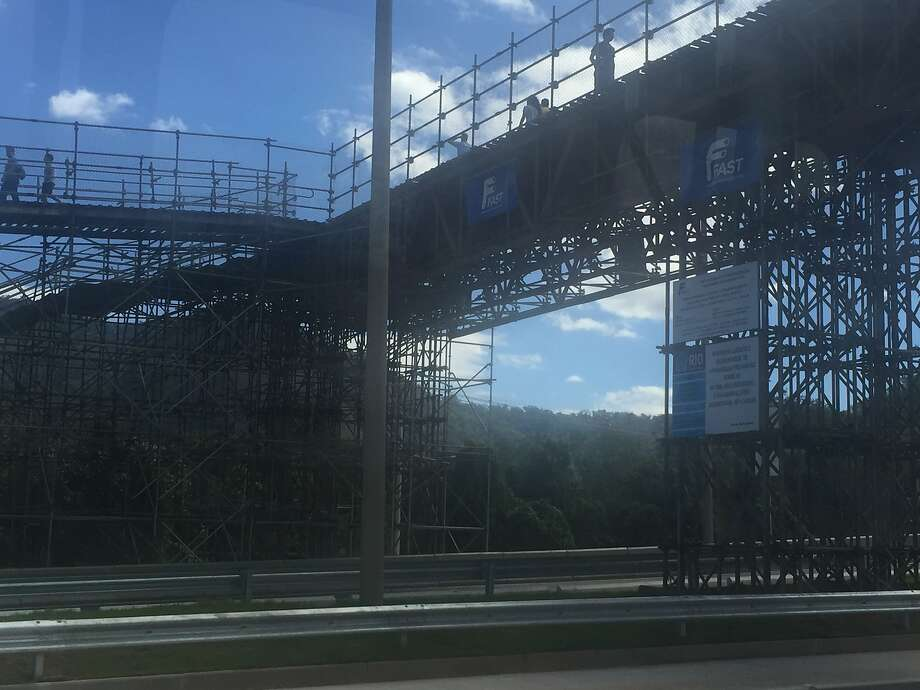 The walkway that carries fans over the road from the buses and into the Olympic Park isn't the most sturdy looking structure. Photo: Ann Killion