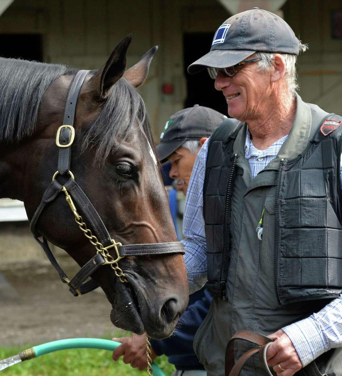 The son of Horse of the Year Zenyatta, Cozmic One is entertained by trainer John Shirreffs Wednesday Aug. 6, 2014 at the Saratoga Race Course in Saratoga Springs, New York. (Skip Dickstein/Times Union)