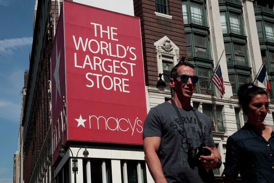 People walk past Macy's flagship store in Herald Square in New York City. On Thursday, Macy's announced plans to close 100 stores nationwide. A news release said the store locations to be closed will be announced once the company makes final decisions. Photo: Drew Angerer /Getty Images / 2016 Getty Images