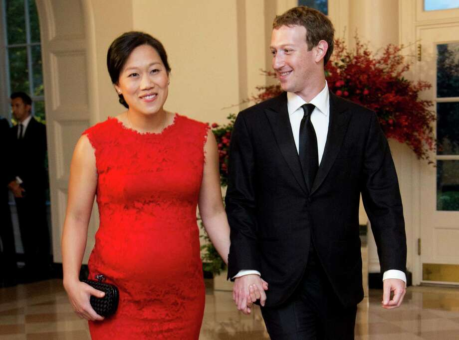 Facebook Chairman and CEO Mark Zuckerberg and his wife, Priscilla Chan, arrive for a state dinner in honor of Chinese President Xi Jinping in the White House. Highly visible executives, like Zuckerberg, have spoken out in favor of paid family leave laws. He announced with a status update on Facebook that he was taking two months of parental leave to help care for his new daughter. Facebook offers 16 weeks of paid leave to new mothers and fathers. Photo: Associated Press /File Photo / Copyright 2016 The Associated Press. All rights reserved. This material may not be published, broadcast, rewritten or redistribu