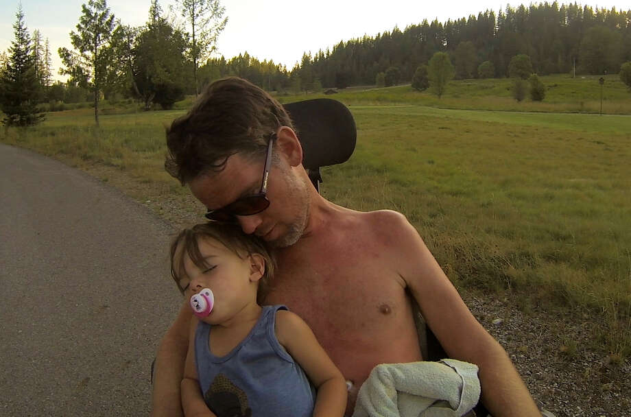 "In this image released by Open Road Films, former New Orleans Saints safety Steve Gleason appears with his son Rivers in a scene from the documentary ""Gleason."" The film follows Gleason and his wife, Michel, into the maelstrom of ALS, or Lou Gehrig's disease, as the couple adjusts to their fluctuating reality and makes way for their son, Rivers. (Open Road Films via AP) ORG XMIT: NYET123 / Open Road Films"
