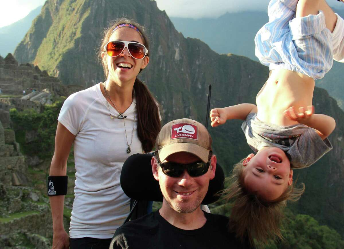 In this image released by Open Road Films, former New Orleans Saints safety Steve Gleason, left, appears with his son Rivers, right, and wife Michel in a scene from the documentary