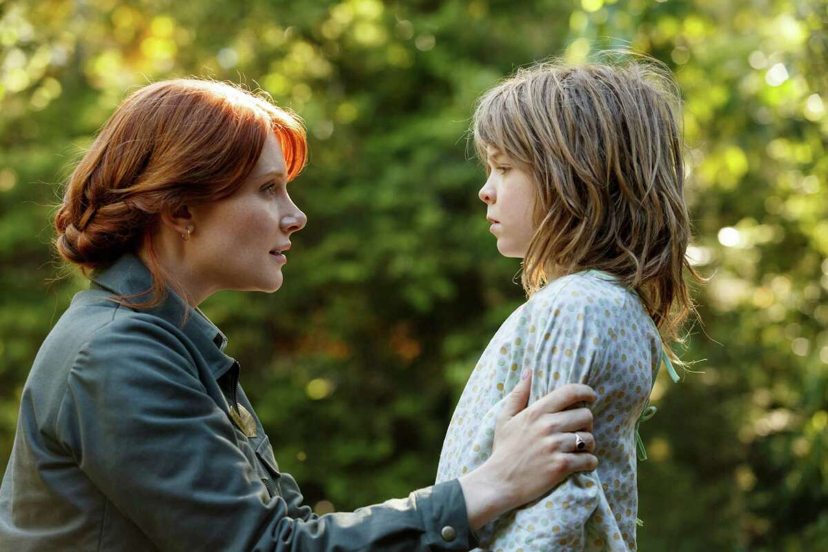 This image released by Disney shows Bryce Dallas Howard, left, and Oakes Fegley in a scene from