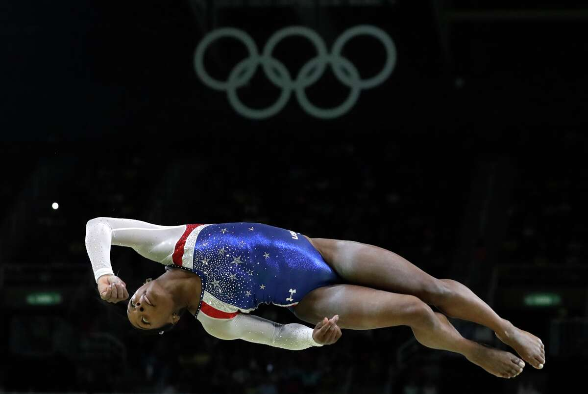 United States' Simone Biles performs on the balance beam during the artistic gymnastics women's individual all-around final at the 2016 Summer Olympics in Rio de Janeiro, Brazil, Thursday, Aug. 11, 2016. (AP Photo/Rebecca Blackwell)