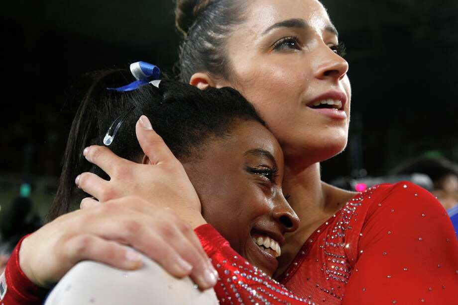 United States' Aly Raisman embraces compatriot Simone Biles after their won silver and gold respectively for the artistic gymnastics women's individual all-around final at the 2016 Summer Olympics in Rio de Janeiro, Brazil, Thursday, Aug. 11, 2016. (AP Photo/Dmitri Lovetsky) Photo: Dmitri Lovetsky/AP