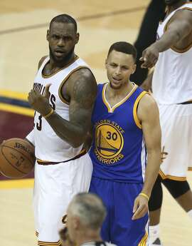 FILE - In this June 16, 2016, file photo, Golden State Warriors guard Stephen Curry reacts to being called for his sixth foul on Cleveland Cavaliers forward LeBron James (23) during the second half of Game 6 of basketball's NBA Finals in Cleveland. A weakened U.S. basketball team believes it�s still the strongest one in the Olympics. LeBron James, Stephen Curry and enough stars to fill an All-NBA team passed on playing, leaving the Americans with a roster that falls short against the Dream Team comparisons they always face. (AP Photo/Ron Schwane, File)