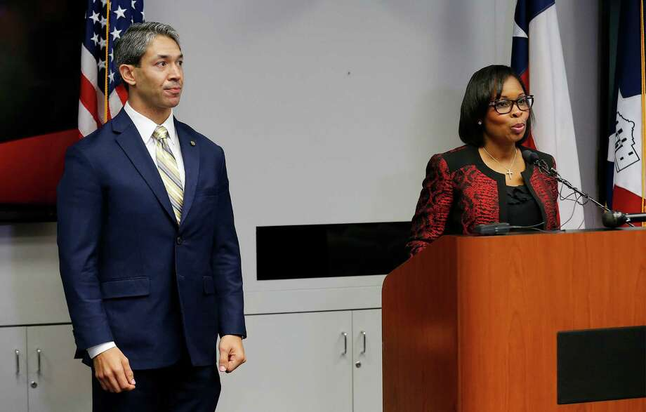 With District 8 Councilman Ron Nirenberg at her side, Mayor Ivy Taylor addresses the media after the City Council approved the three SA Tomorrow plans earlier this month. A reader says the mayor is playing politics with her decision to dissolve a panel headed by Nirenberg. Photo: Kin Man Hui /San Antonio Express-News / ©2016 San Antonio Express-News