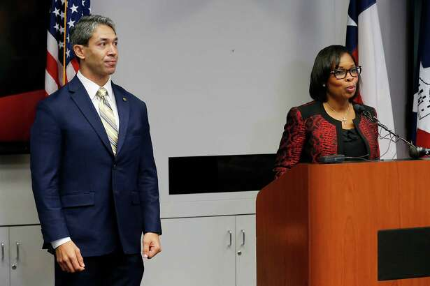 With District 8 Councilman Ron Nirenberg at her side, Mayor Ivy Taylor addresses the media after the City Council approved the three SA Tomorrow plans earlier this month. A reader says the mayor is playing politics with her decision to dissolve a panel headed by Nirenberg.