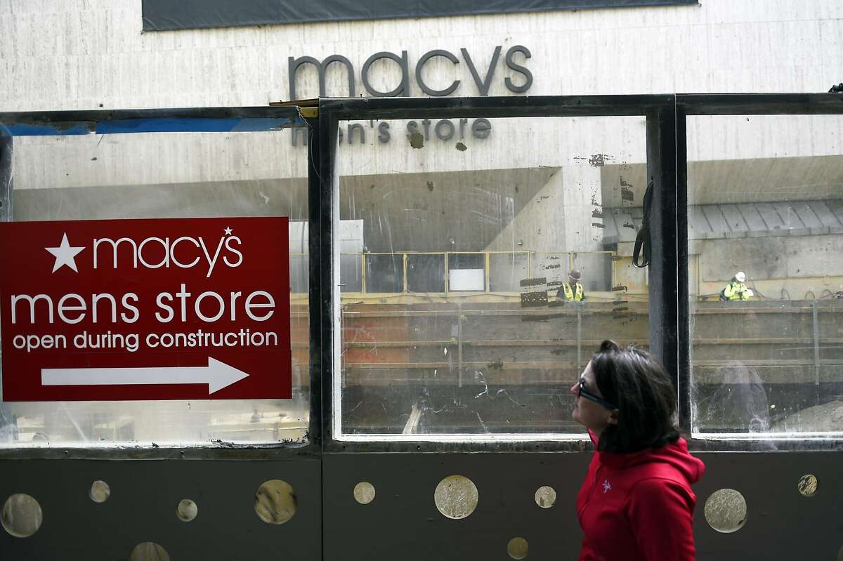 Pedestrians walk past the Macy's Men's Store in Union Square on August 11, 2016 at in San Francisco, California.