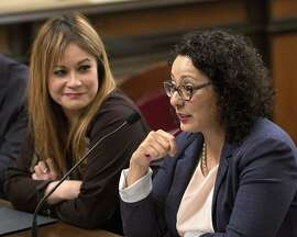 Assemblywoman Cristina Garcia, D-Bell Gardens, right, urges lawmakers to approve her measure to exempt tampons and other feminine hygiene products from sales tax as co-author Assemblywoman Ling Ling Chang, R-Diamond Bar, looks on, Wednesday, June 22, 2016, in Sacramento, Calif. The bill, AB1561, was approved by the Senate Governance and Finance committee. (AP Photo/Rich Pedroncelli)