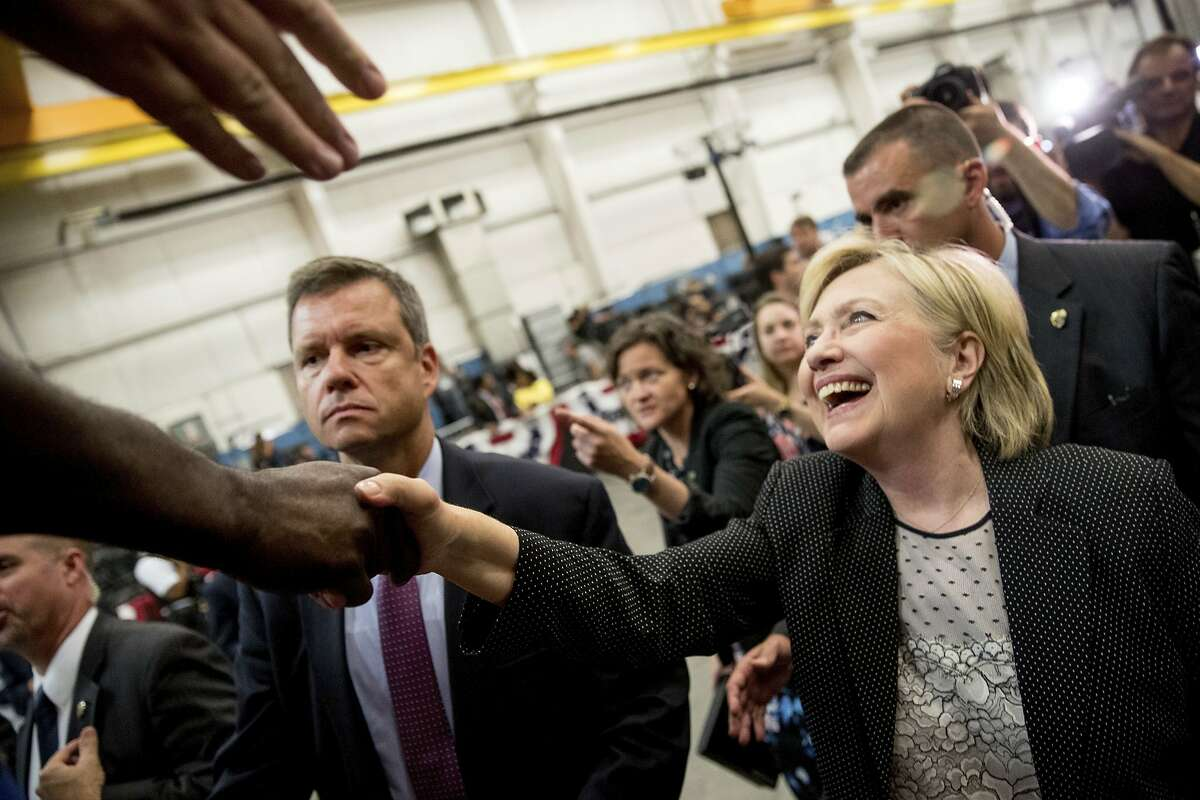 Democratic presidential candidate Hillary Clinton greets supporters after giving a speech on the economy at Futuramic Tool & Engineering, in Warren, Mich., Thursday, Aug. 11, 2016. (AP Photo/Andrew Harnik)