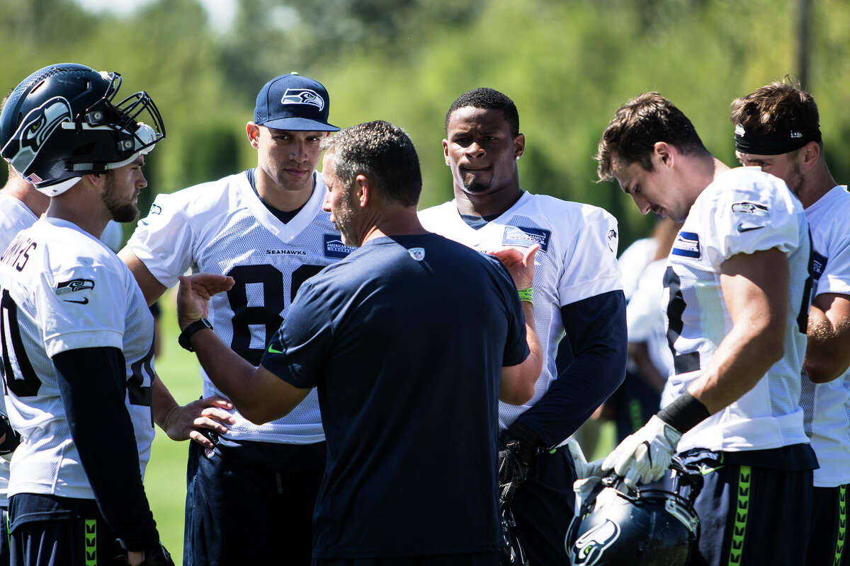 Tight ends coach Pat McPherson gives his final thoughts to a group of Seahawks players at the end of training camp at Virginia Mason Athletic Center in Renton on Thursday, Aug. 11, 2016. (Lacey Young, seattlepi.com)
