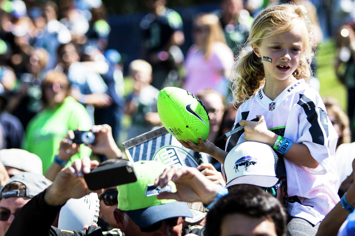 A young fan shouts to Russell Wilson as he signs autographs after training camp at Virginia Mason Athletic Center in Renton on Thursday, Aug. 11, 2016. (Lacey Young, seattlepi.com)