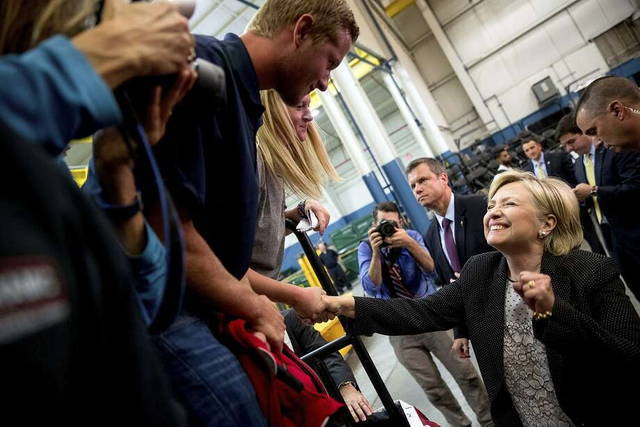 Hillary Clinton greets supporters at a factory in Warren, Mich., where she spelled out her vision for the economy. Photo: Andrew Harnik, Associated Press