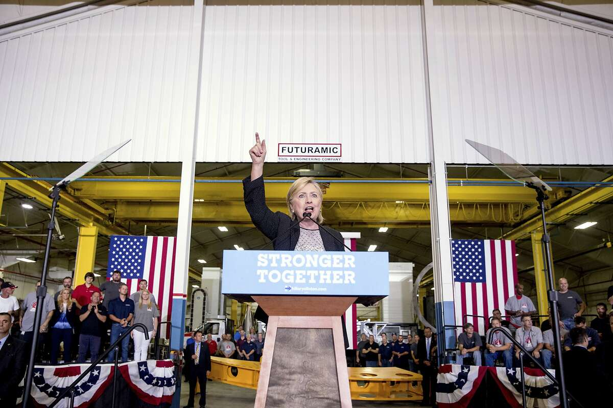 Democratic presidential candidate Hillary Clinton gestures as she gives a speech on the economy after touring Futuramic Tool & Engineering, in Warren, Mich., Thursday, Aug. 11, 2016. (AP Photo/Andrew Harnik)