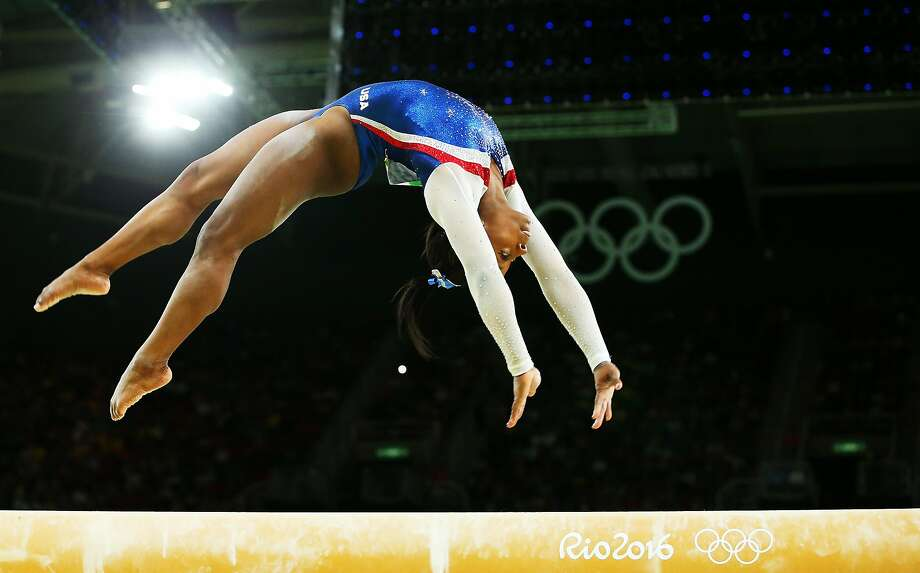 Simone Biles of the United States competes on the balance beam during the individual all-around final in the Rio Games. Photo: Alex Livesey, Getty Images